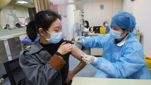 International: En Chine,  des non-vaccinés risquent la prison